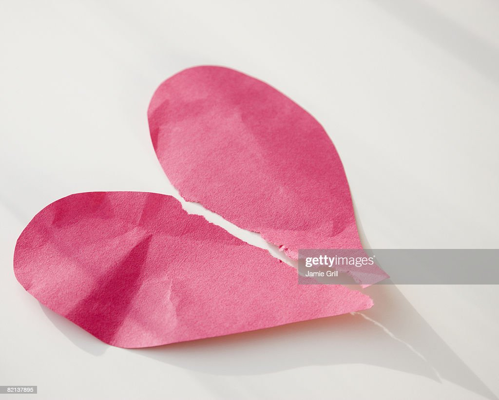 Paper heart ripped in half : Stock Photo