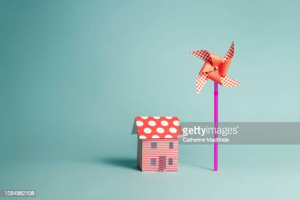 paper home and paper windmill - catherine macbride stock pictures, royalty-free photos & images