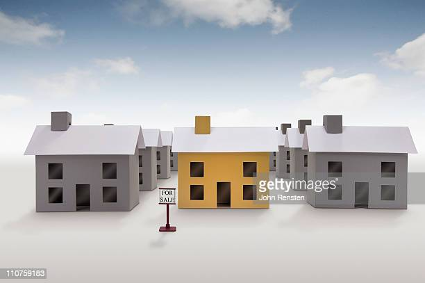 paper houses and homes in streets and villages