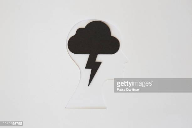 paper human head with thunder cloud - mental illness stock pictures, royalty-free photos & images