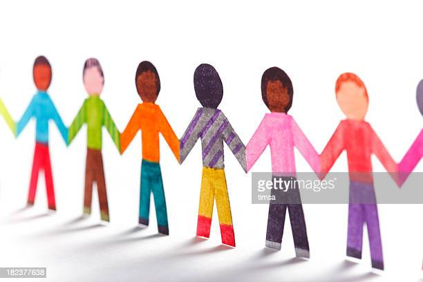Paper kids wearing colorful clothes holding hands