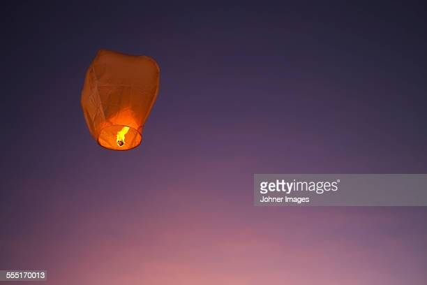 paper lantern against sky - lantern stock photos and pictures