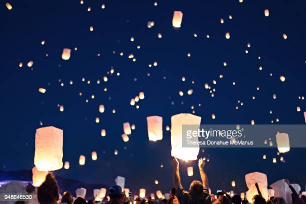 paper lantern festival over the desert at lake pleasant, phoenix, arizona - releasing stock pictures, royalty-free photos & images