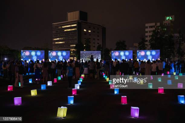 Paper lanterns are placed on the ground to mark social distancing rules during a virtual lantern show to replace the traditional lantern ceremony...