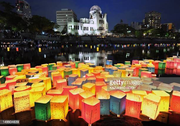 Paper lanterns float on the Motoyasu River in front of the Atomic Bomb Dome in Hiroshima on August 6 2012 Tens of thousands of people marked the 67th...