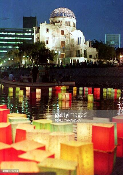 Paper lanterns float on the river in front of the Atomic Bomb Dome 06 August 1993 in remembrance of the 180000 people killed when the US dropped an...