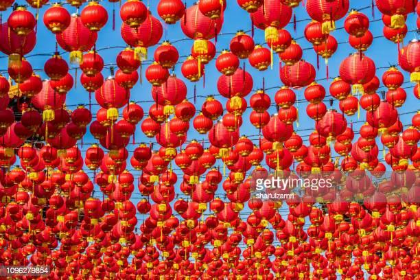 paper lanterns hanging for chinese new year celebration. - shaifulzamri 個照片及圖片檔
