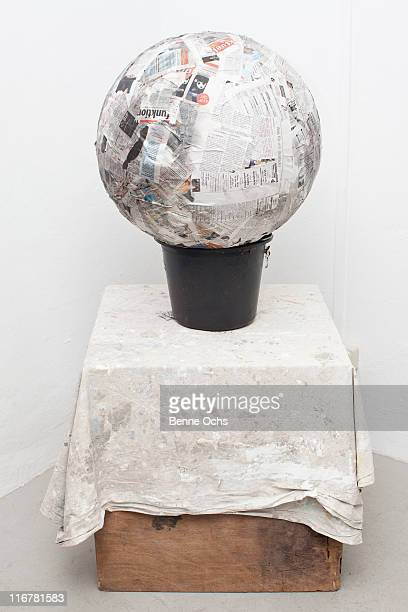 Paper Mache ball on bucket on box.