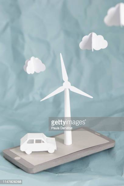 3d paper mobile phone with a car and a wind turbine - portability stock pictures, royalty-free photos & images