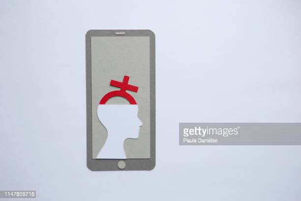 Paper mobile phone with a head with female gender symbol