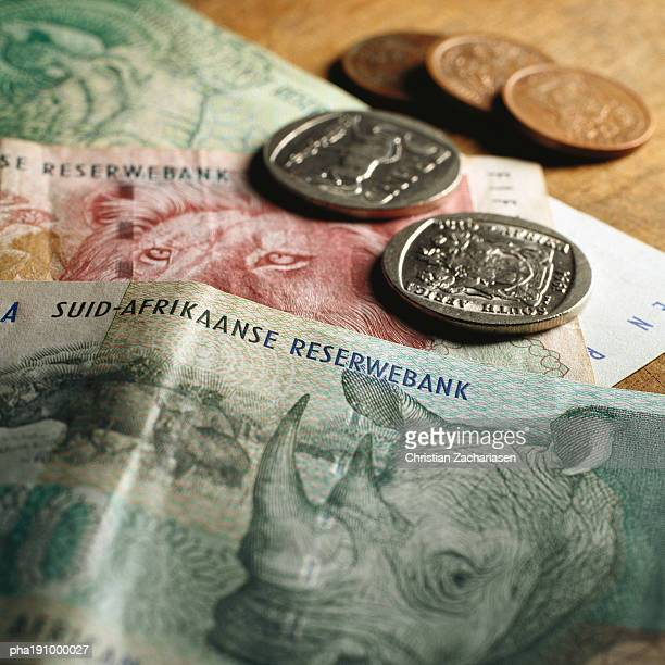 paper money and coins. - south african currency stock pictures, royalty-free photos & images