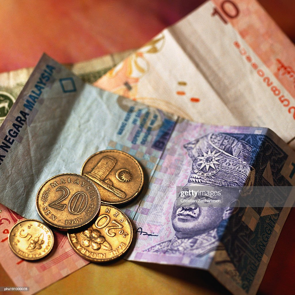 Paper money and coins. : Stockfoto