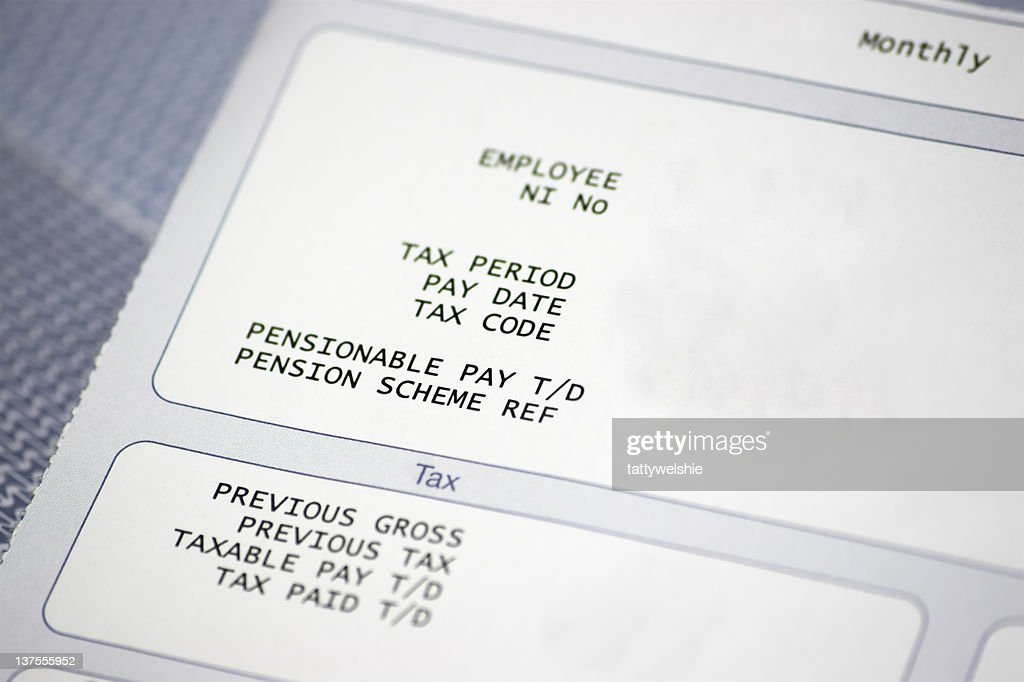 Paper pay slip with tax and pension information : Stock Photo