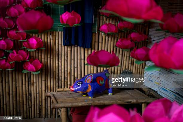 A paper pig are for sale as home decoration on the site of Van Mieu Literature Temple on the first day of Lunar New Year 2019 Year of the Pig on...