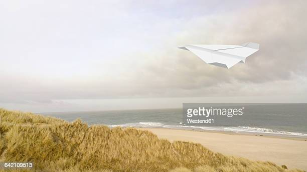 Paper plane, beach in the background, 3D Rendering