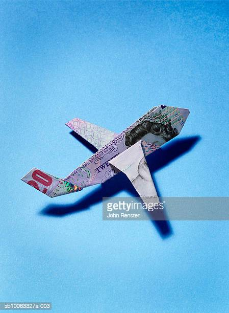 paper plane made from twenty pound banknote - british pound sterling note stock pictures, royalty-free photos & images