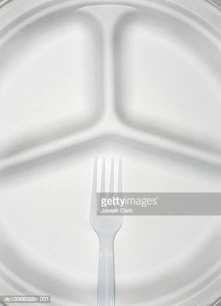 paper plate and plastic fork, close-up - plastic plate stock photos and pictures