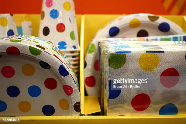 paper plates and tissue papers with polka dots for sale in store - paper plate stock photos and pictures