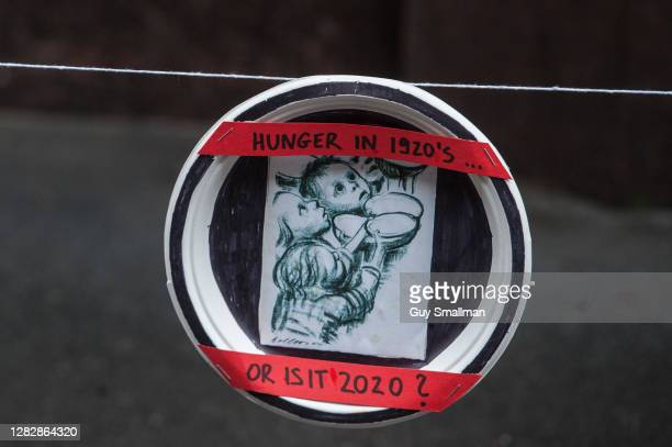 Paper plates are attached to the Department for Education building by members of the National Education Union and their supporters during a protest...