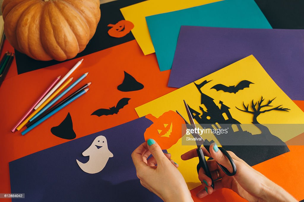 Paper Pumpkin On The Background Halloween Decorations Stock Photo