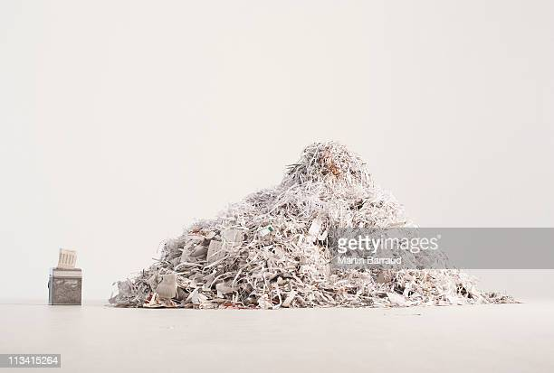 paper shredder and pile of shredded paper - heap stock pictures, royalty-free photos & images