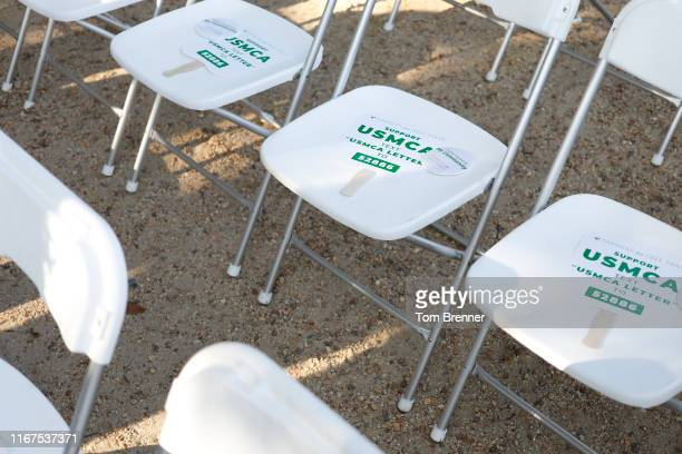 Paper signs of support are placed on audience members' chairs before a rally for the passage of the USMCA trade agreement on September 12 2019 in...