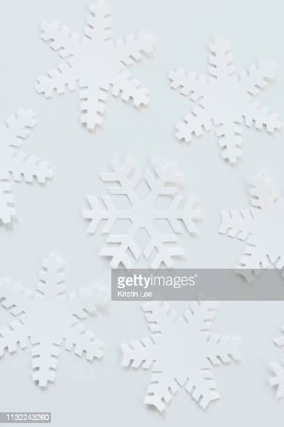 paper snowflakes - snowflake background stock photos and pictures