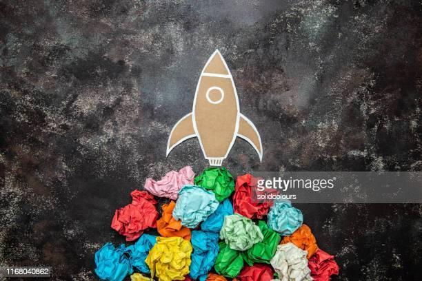 paper space rocket - stapellauf stock-fotos und bilder