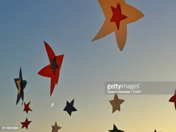 Paper stars against clear sky