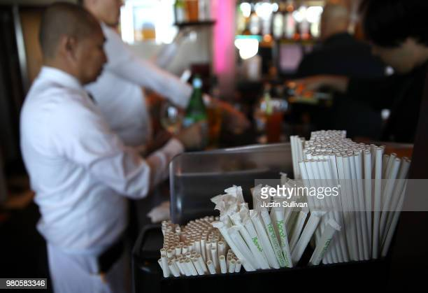 Paper straws sit in cocktails at Wipeout Bar Grill on June 21 2018 in San Francisco California San Francisco Oakland and Berkeley are all considering...