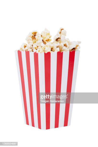 paper striped bucket with popcorn isolated on white background with clipping path. - ポップコーン ストックフォトと画像