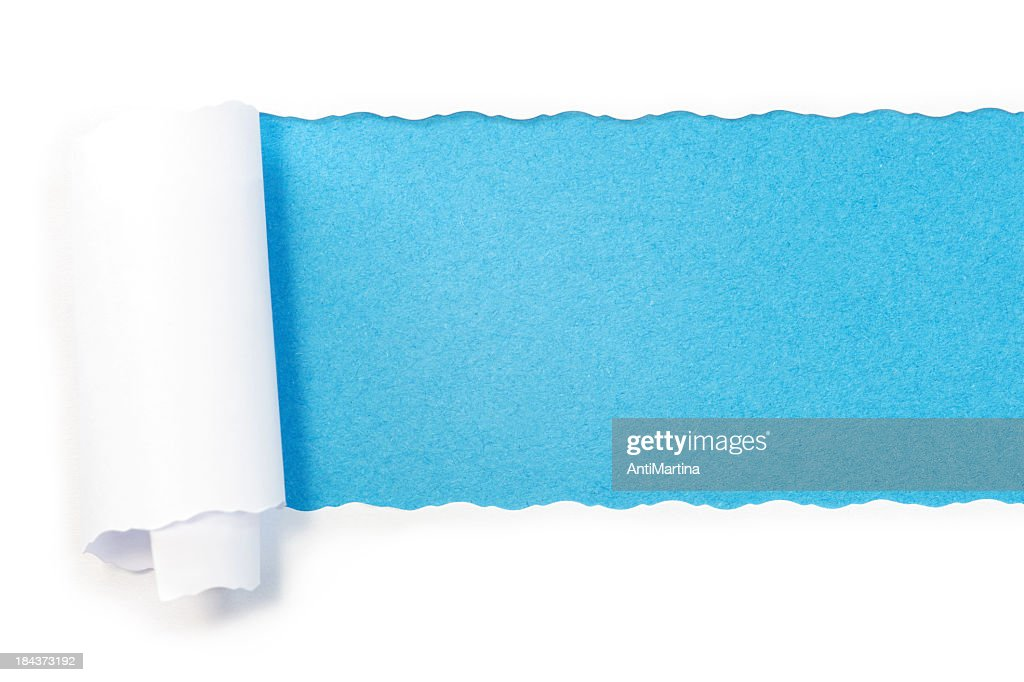 Paper torn into roll revealing blue underneath : Stock Photo