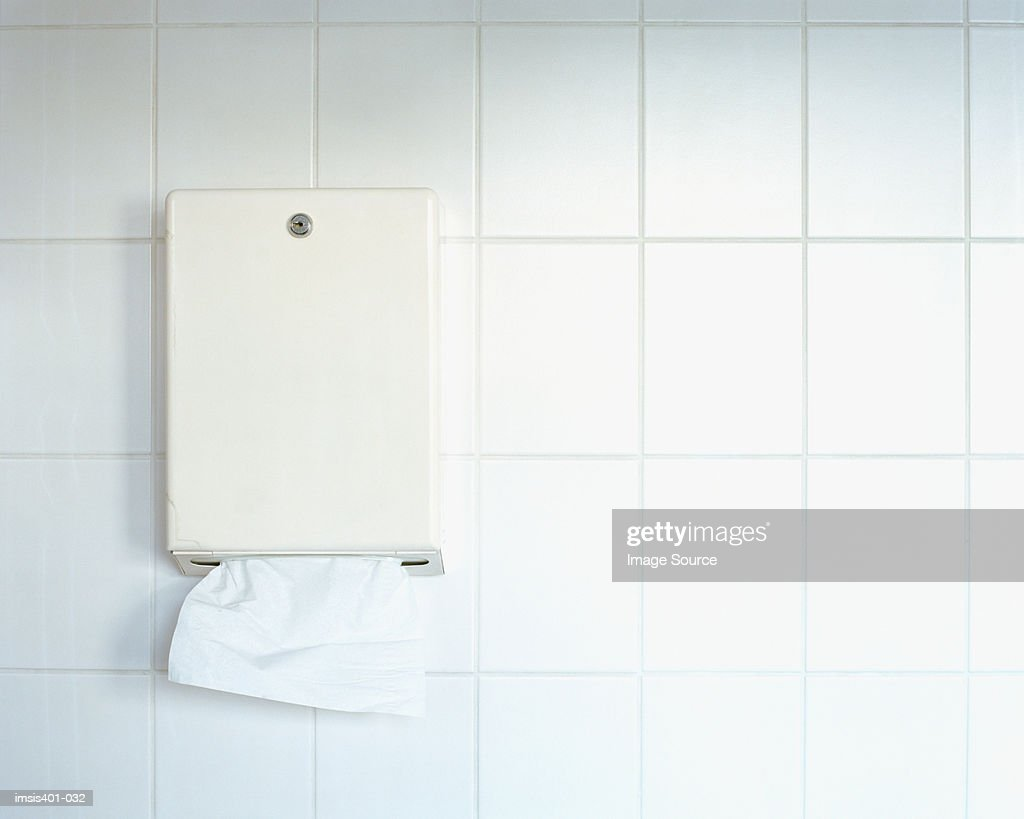 Paper towel dispenser on wall : Stock Photo
