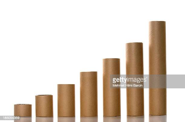 paper tubes like a graph - cylinder stock pictures, royalty-free photos & images