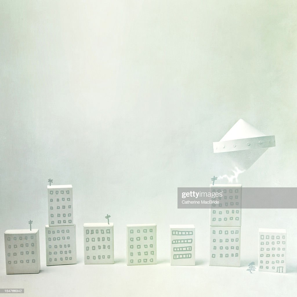 Paper UFO Flies over Paper City : Stock Photo