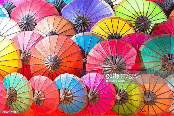 paper umbrella in luang prabang - didier marti stock photos and pictures