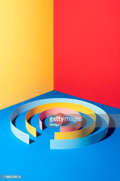 paper wall surrounding red sphere - direction stock pictures, royalty-free photos & images