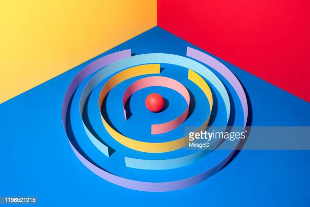 paper wall surrounding red sphere - protection stock pictures, royalty-free photos & images