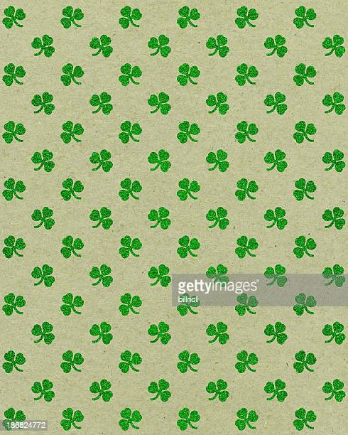 paper with glitter clover pattern - st patricks background stock pictures, royalty-free photos & images