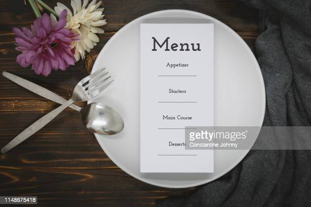 paper with menu on dining plate over rustic wood - menu stock pictures, royalty-free photos & images