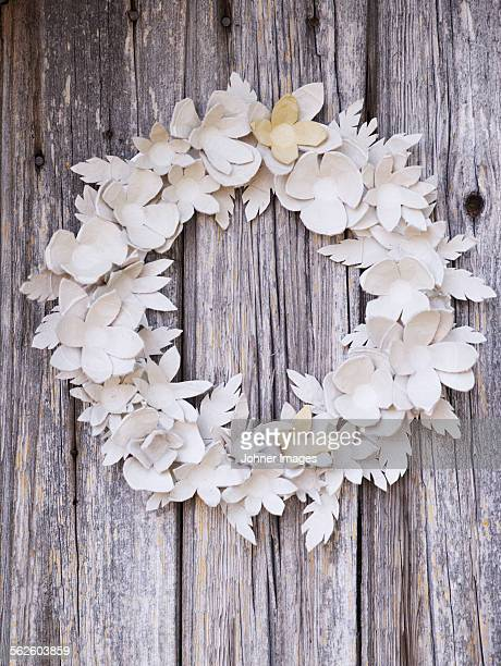 Paper wreath on wooden wall