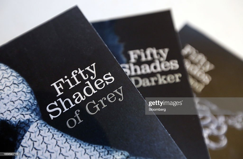 Paperback editions of the 'Fifty Shades' trilogy by E.L. James, published by the Arrow, are arranged for a photograph at the U.K. headquarters of Random House in London, U.K., on Friday, April 5, 2013. Bertelsmann SE's Random House won European Union approval to buy Pearson Plc's Penguin unit to create the largest book publisher in the U.K. and the U.S. Photographer: Chris Ratcliffe/Bloomberg via Getty Images