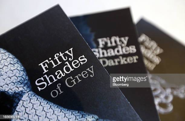 Paperback editions of the 'Fifty Shades' trilogy by EL James published by the Arrow are arranged for a photograph at the UK headquarters of Random...