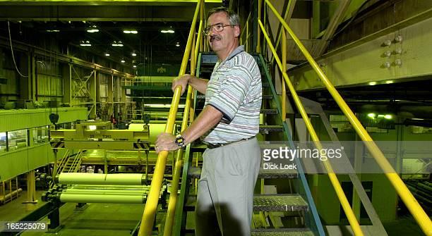 Paperboard 0803101Paperboard Toronto General Manager Claude Marois mill in backround Dick Loek Toronto Star
