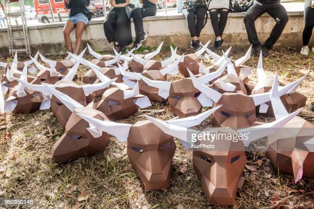 Paperboard bullhead mask during the preparations of a protest against the animal cruelty in bullfightings before the San Fermin celebrations in...