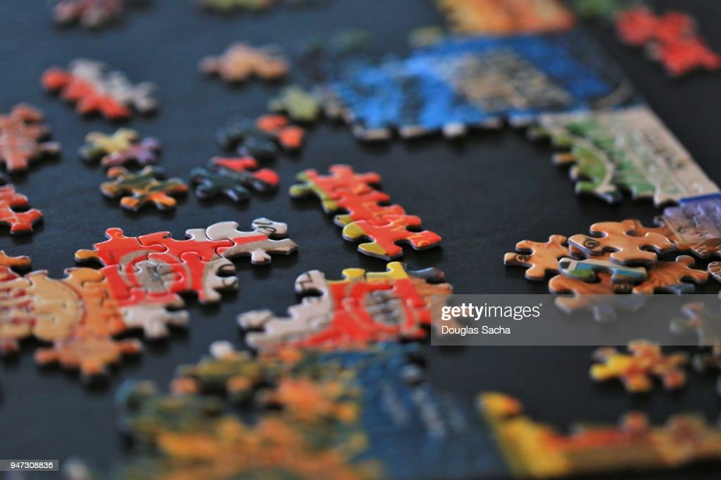 Paperboard jigsaw puzzle pieces : Stock Photo