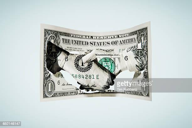 Paper-cut dollar - Handshake with single dollar.