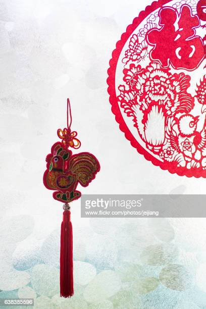 Paper-cutting of chicken and Chinese New Year ornaments
