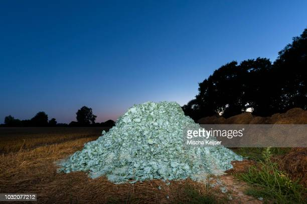 Paper-maché used to screen piles of manure