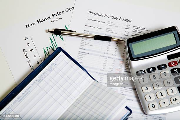 Papers and a calculator to work out rising costs of living